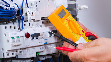 Qualified and registered electrician